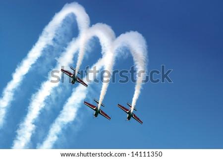 Aerobatic team making loopings in the air - stock photo