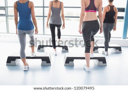 Aerobics class in session in gym - stock photo