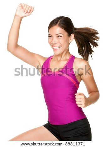 Aerobics fitness woman doing dance training move smiling fresh and happy with energy. Beautiful multiracial female fitness model. - stock photo