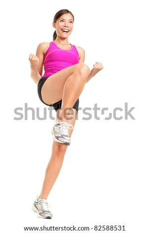 Aerobics fitness woman instructor exercising isolated in full body. Happy smiling and energetic fit female fitness model in pink top. - stock photo