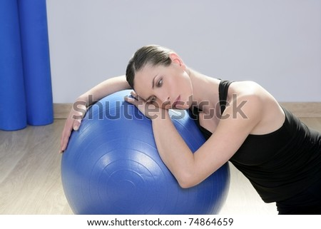 aerobics fitness woman relax pilates stability blue ball in sport gym - stock photo