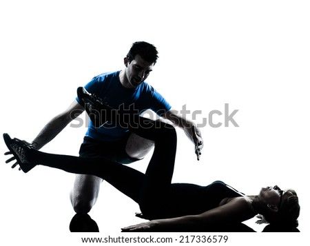 aerobics instructor with mature woman exercising fitness workout in silhouette studio isolated on white background - stock photo