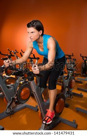 Aerobics woman workout on orange bike - stock photo