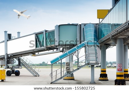aerobridge at airport - stock photo