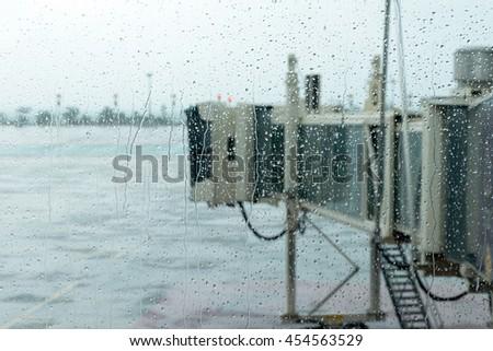 aerobridge in plane parked with rainy day - stock photo