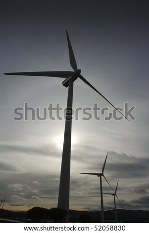 aerogenerator electric windmill on sunset cloudy sky