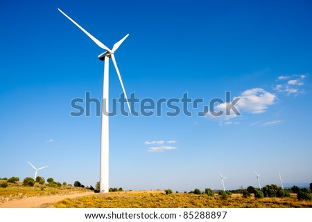 aerogenerator windmill blue sky and golden field - stock photo