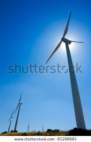 aerogenerator windmill blue sky sun backlight
