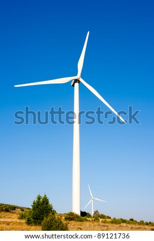 aerogenerator windmill in sunny blue sky day - stock photo