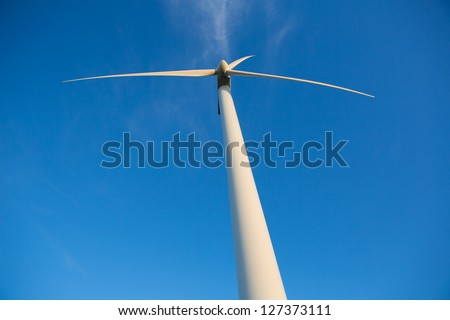 Aerogenerator windmills for green electric energy from below and ble sky background
