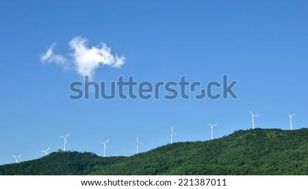 Aerogenerator windmills in the mountain top  - stock photo