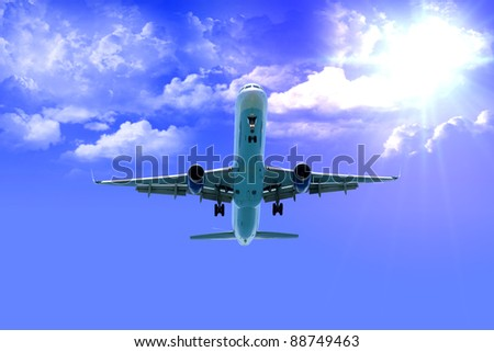 aeroplane after take off with good weather - stock photo