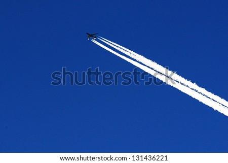 Aeroplane against the blue sky - stock photo