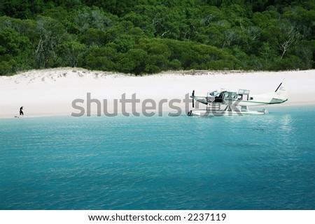 Aeroplane arrives on Whitehaven beach, Queensland, Australia - stock photo
