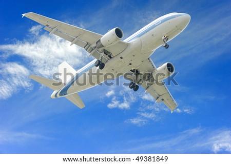 aeroplane on blue sky background - stock photo