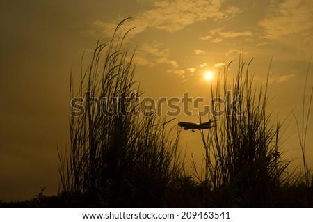 Aeroplane ready to landing at airport in Kuala Lumpur - stock photo