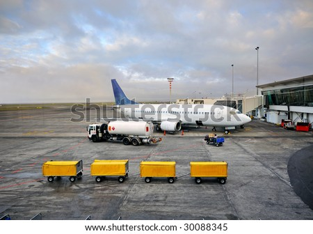aeroplane waiting for loading up at the airport in early morning - stock photo