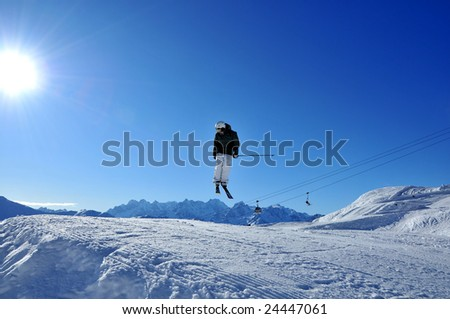 Aeroski: A skier performing aerial skiing is about to land backwards
