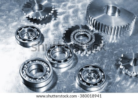 aerospace technology, ball-bearings and gears of titanium, bluish toning concept - stock photo