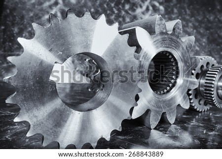 aerospace titanium cogwheels and engineering parts against aluminum - stock photo