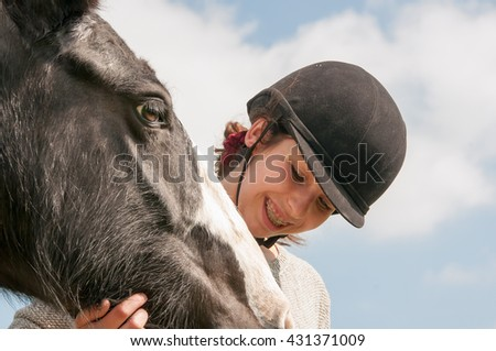 Affection from a young girl towards a beautiful horse