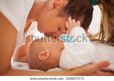 Affection moment between young mother and her baby boy - stock photo