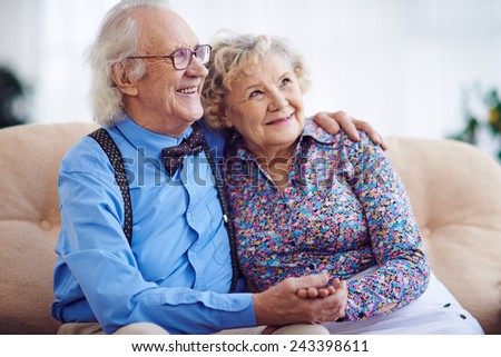 Affectionate aged couple in smart clothes - stock photo