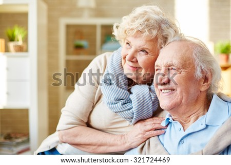 Affectionate and cheerful senior couple - stock photo