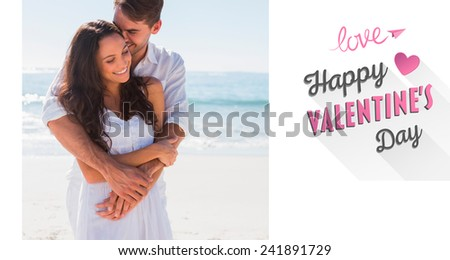 Affectionate couple cuddling against cute valentines message - stock photo