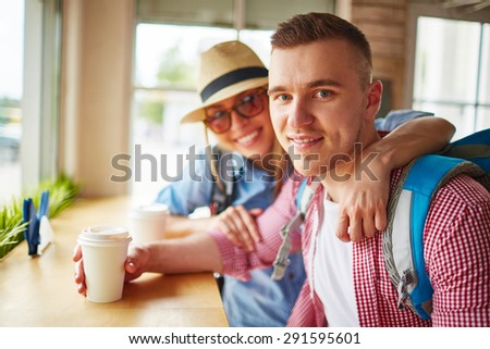 Affectionate couple having drink in cafe
