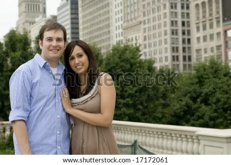 Affectionate couple posing outside - stock photo