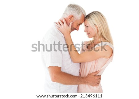 Affectionate couple standing and hugging on white background - stock photo