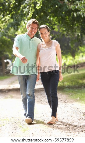 Affectionate Couple Walking In Countryside Together