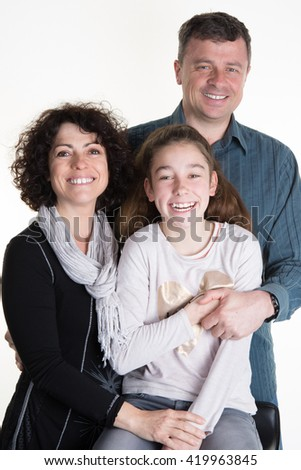 Affectionate family looking at the camera - stock photo