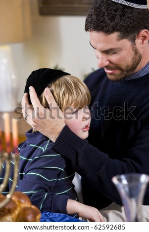 Affectionate father and 4 year old son celebrating Hanukkah