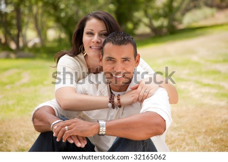 Affectionate Happy Hispanic Couple in the Park. - stock photo