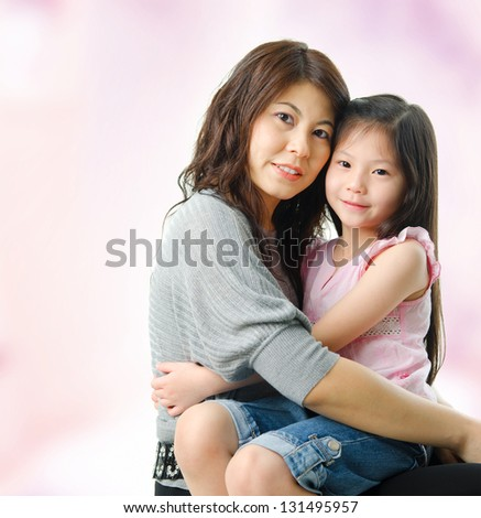 Affectionate Mother And Daughter At Home. Asian parent and child.