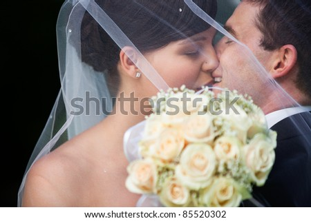 Affectionate newly wed couple kissing - stock photo