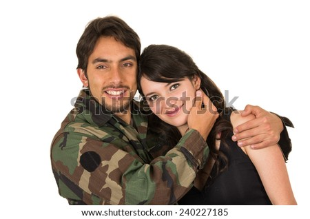 affectionate returning young military soldier hugging his wife girlfriend isolated on white - stock photo