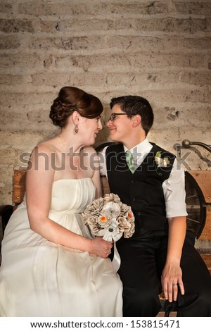 Affectionate same sex newlywed couple close together - stock photo