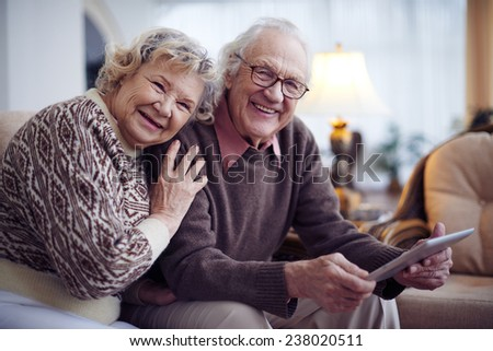 Affectionate senior couple having rest at home - stock photo
