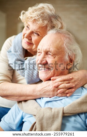 Affectionate senior female embracing her husband - stock photo