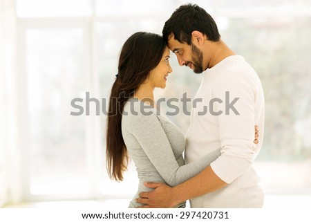 affectionate young couple hugging at home - stock photo