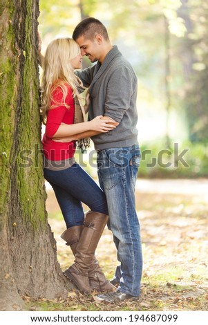 Affectionate young couple in a park - stock photo
