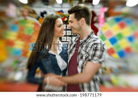 affectionate  young couple visiting an attractions park  - shoot with lens baby  - stock photo