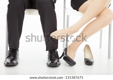 affections between business man and woman in office - stock photo