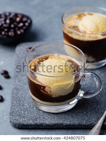 Affogato coffee with ice cream on a glass cup Grey slate background - stock photo