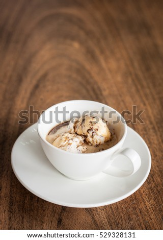 Affogato cup on top old wood