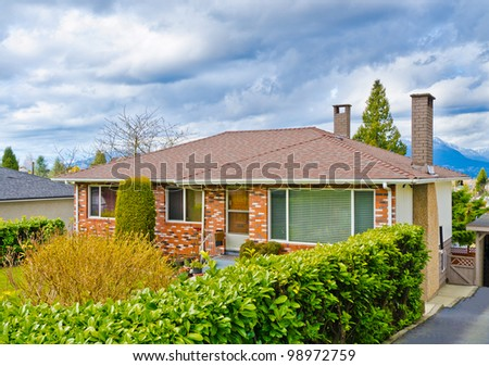 Affordable house with rich green in Vancouver, Canada. - stock photo