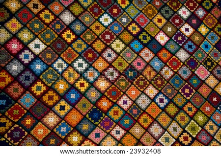 Afghan of granny squares - stock photo